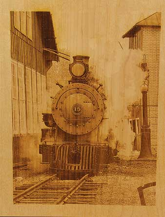 A train engraving on wood